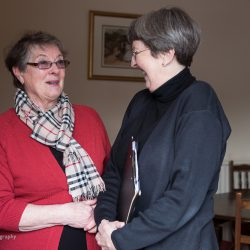 Two ladies talking and laughing together